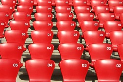 Detailed view on tribune seats in a football - olympic atletic stadium