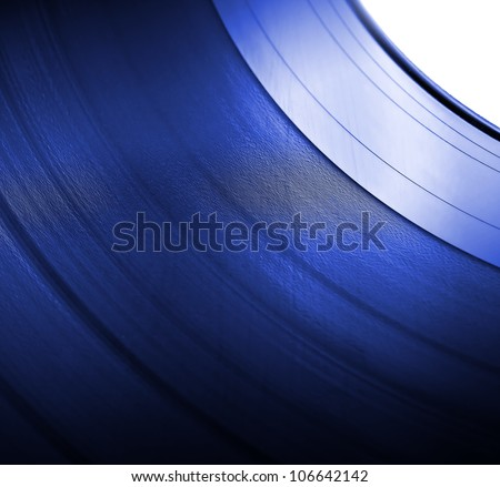 Detailed vinyl LP close up blue background with shallow depth of field