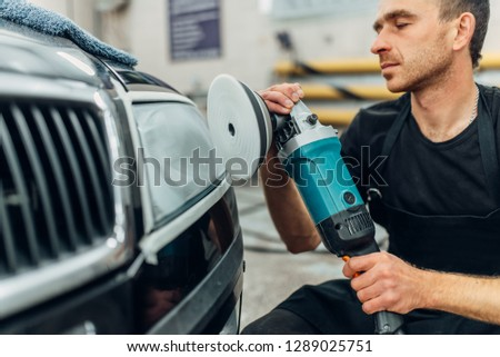 Detailing of car headlight on car-wash service