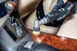 detailing specialist polishes lacquered car parts with tool