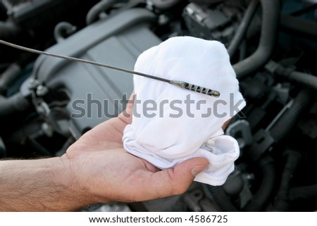 Details checking engine oil dipstick in car