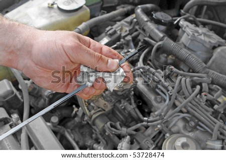 Details checking engine oil dipstick in the car