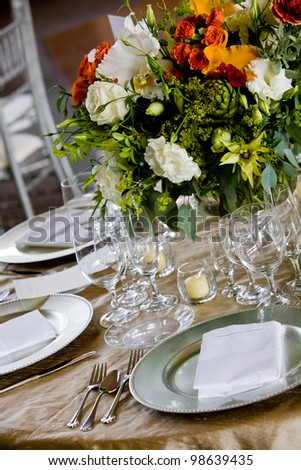 details from a wedding. Table set for fine dining with a pretty bouquet