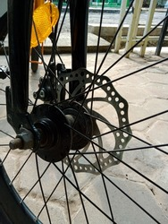 Details of a bicycle's wheel. Bicycle spoke.