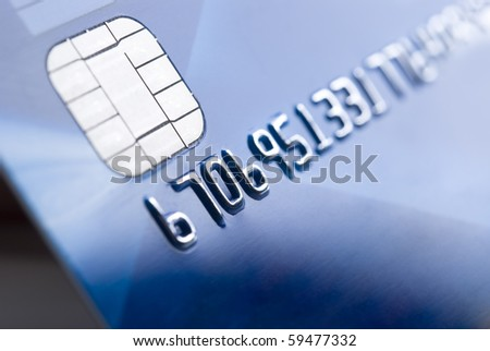 Details of a credit card with chip and numbers, shallow DOF