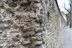 details of a historical roman wall in the old town of cologne