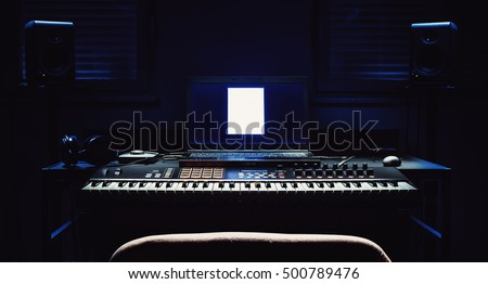 Details of a home studio, dark room with accentuated equipment shapes.