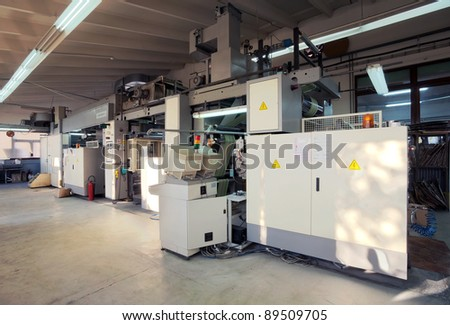 Details of a printing machine inside factory.