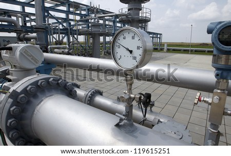 Details of a valve or pump that is part of a complex industrial pipeline system.