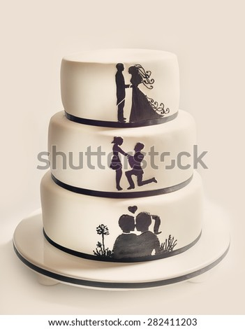Details of a wedding cake, white sugar cream and black silhouettes.