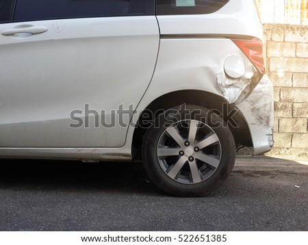 Details of a white car in an accident, Car crash, insurance, soft focus, light effect. #522651385