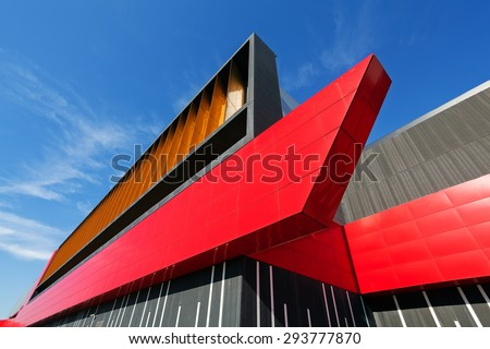 details of aluminum facade with colorful red and orange panels on large shopping mall #293777870