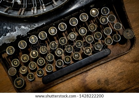 Details of an old retro, Antique Typewriter Keyboard. Vintage style, dusty surfaces, Close up Photo #1428222200