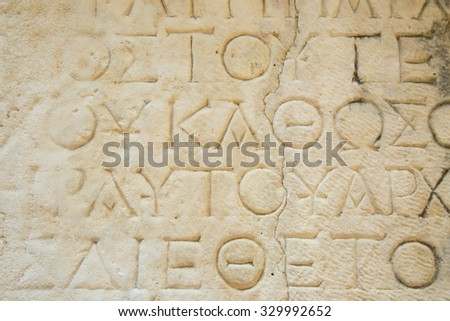 Details of ancient greek letters in a stone â?? at a historical site in Phaselis at the mediterranean sea in Turkey