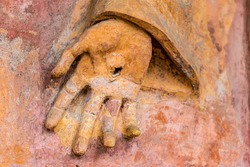 details of ancient statue, a hand with stigmata
