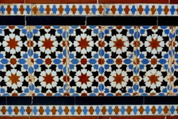 Details of antique mudejar-style tiles, also known as azulejos, in the courtyard of a traditional Andalusian palace in Seville, Spain