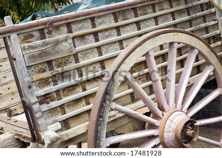 Details of antique wood cart with big wheels on park stock photo