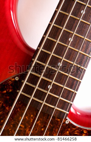 Details of bass guitar with 5 strings.