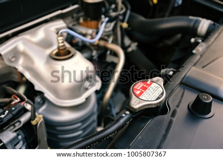 details of car engine, car radiator cap, old film look effect