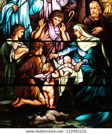 Details of Christmas stained glass window depicting birth of Jesus, with Mary, Joseph and shepherds