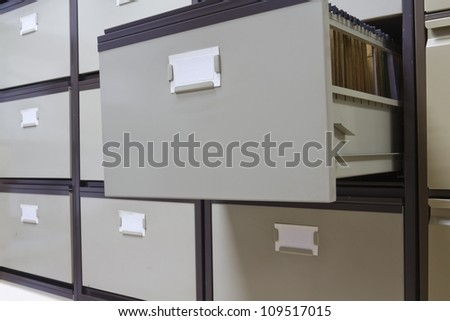 Details of each open file cabinets in an office
