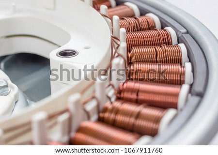 Details of electric motor washing machine close up. coil