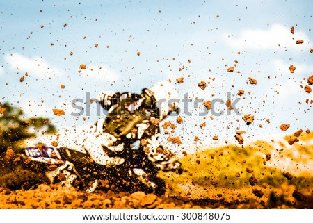 Details of flying debris during a motocross race