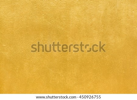 Details of golden texture background. Gold color painted on cement wall  for background and wallpaper #450926755