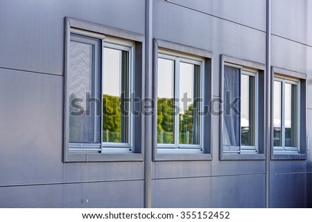 Details of gray facade made of aluminum panels on industrial building #355152452