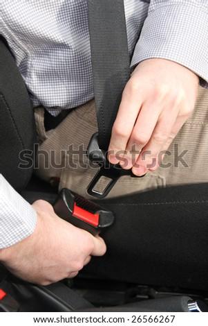 details of hands putting on safety belt