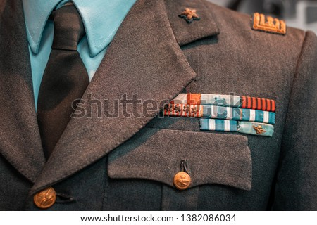 Details of historical Italian military uniforms. Grades and patches on high quality fabrics. Vintage style suits, European taste for elegance.