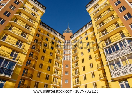 Details of new constructed colorful multi-story building. Modern residential construction. Residential fund #1079792123