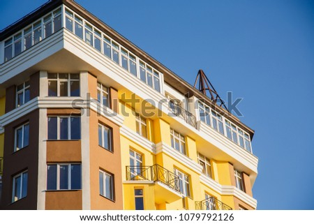 Details of new constructed colorful multi-story building. Modern residential construction. Residential fund #1079792126