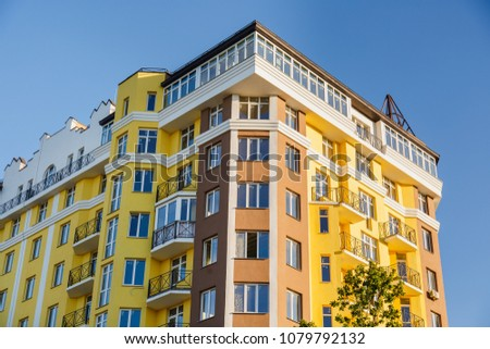 Details of new constructed colorful multi-story building. Modern residential construction. Residential fund #1079792132
