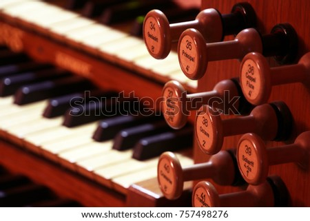 Details of pipe organ stops (knobs for changing voices) (selective focus) #757498276