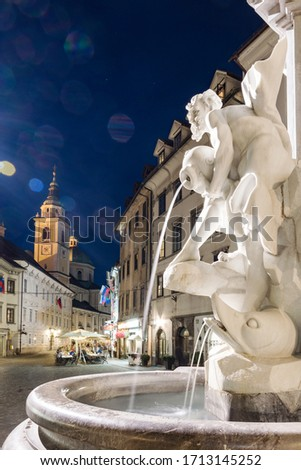 Details of Robba fountain on a summer night in Ljubljana city square