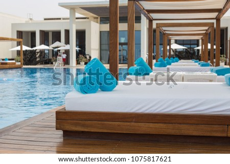 Details of Saadiyat beach club Abu Dhabi (beds near the pool). Vacation concept