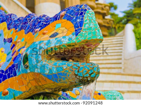 Details of the ceramic dragon fountain at Parc Guell designed by Antoni Gaudi, Barcelona, Spain.