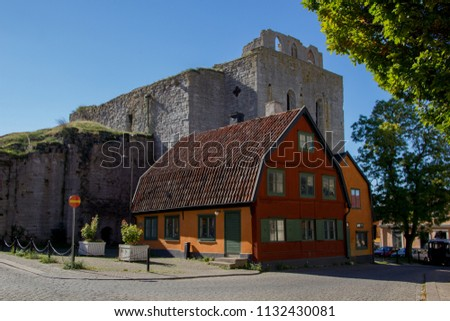 Details of the city called Visby, Gotland in Sweden, Church towers and watchtowers are dominating the city center everywhere. Blue sky on background, creating unique scenic city landscape with flair