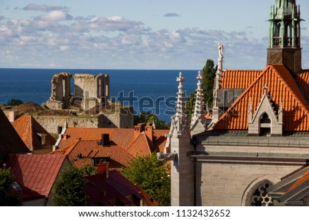 Details of the city called Visby, Gotland in Sweden, Church towers, watchtowers and old ruins are dominating the city center, creating unique scenic city landscape with special flair with Baltic sea