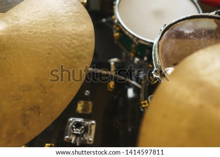 Details of the drum set on the scene close-up. Musical instruments and musical performance. Drums.  Hi-Hat, tam-tam, Microphone close up.