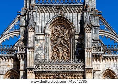 Details of the facade of the 14th century Batalha Monastery in Batalha, Portugal, a prime example of Portuguese Gothic architecture, UNESCO World Heritage site. #743042785