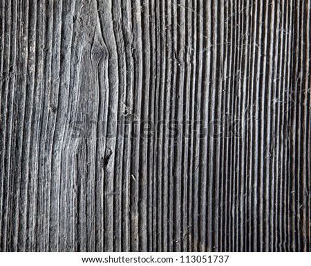 Details of wood. A plank, fence, structure.