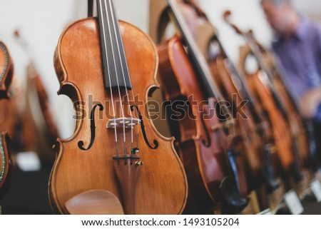 Details with parts of violins before a symphonic classical concert Stock fotó ©
