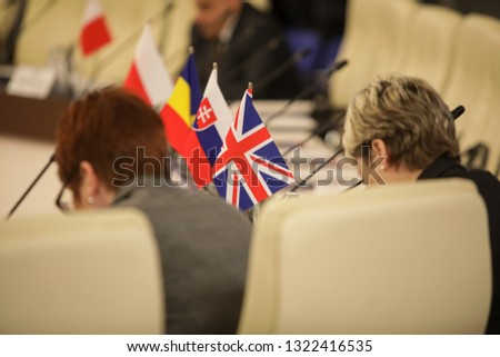 Details with the flag of the United Kingdom during a conference of European Union officials #1322416535
