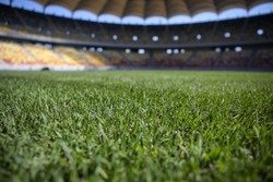 Details with the freshly installed and trimmed new turf on a soccer stadium