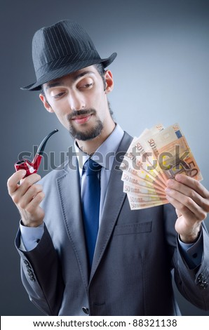 Detective looking at fake money