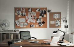 Detective office interior with big wooden desk and evidence board