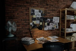 Detective workplace near brick wall in office
