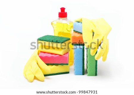 Detergent bottle, rubber gloves and cleaning sponge on a white background.